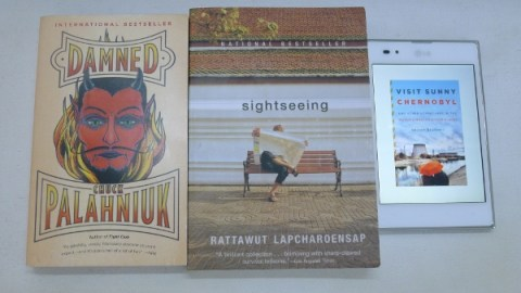 """Damned"" by Chuck Palahniuk, ""Sightseeing"" by Rattawut Lapcharoensap, and ""Visit Sunny Chernobyl"" by Andrew Blackwell. The LG Optimus Vu phablet in the photo isn't mine; I was reviewing it at the time I took the photo."