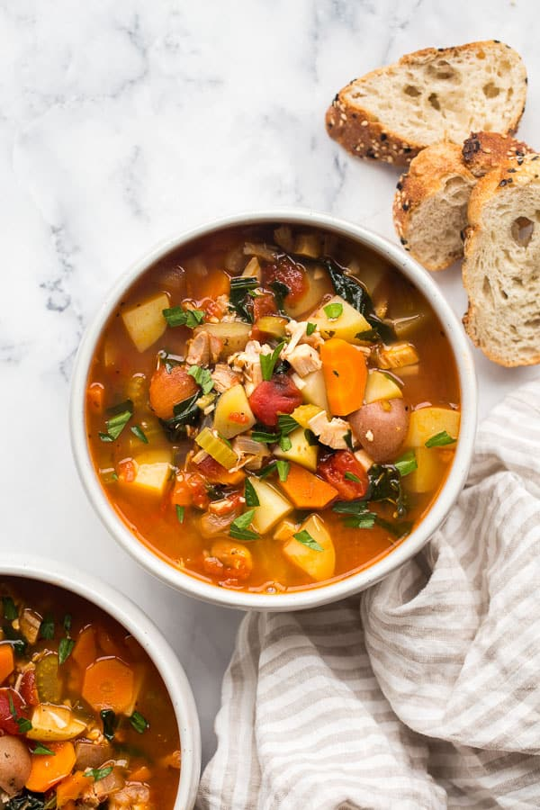 close up image of one bowl of chicken vegetable soup