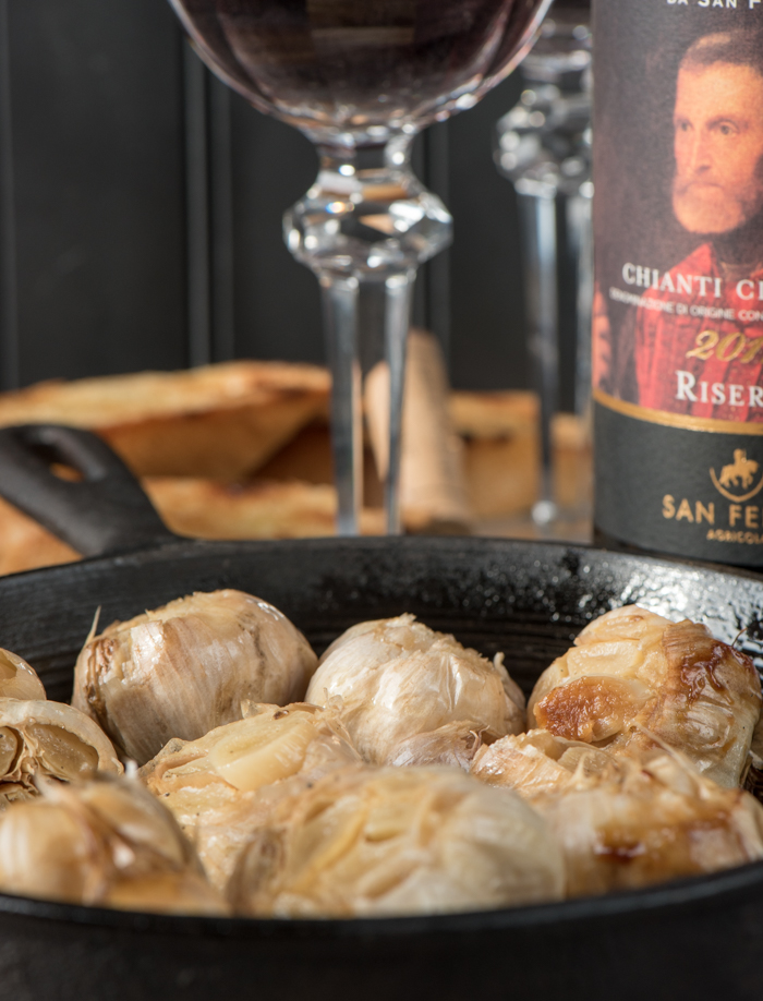 Roasted garlic bulbs make an easy and tasty appetizer. Spread on toasted baguettes and serve with red wine for a real treat! | The Recipe Wench