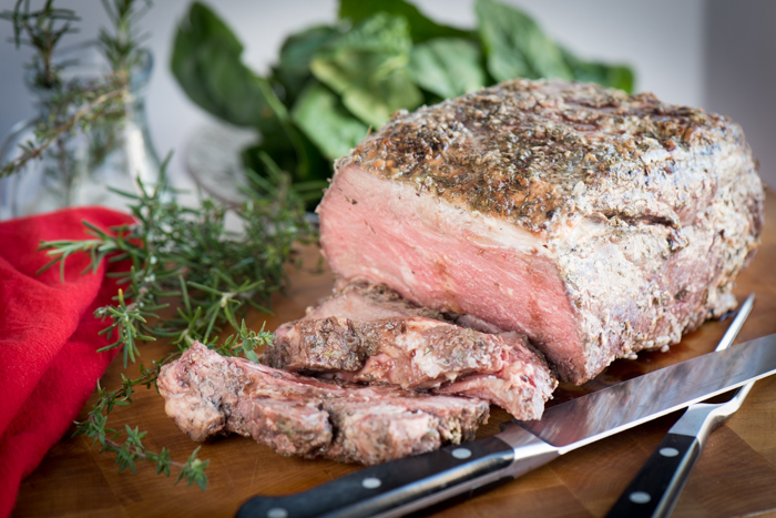 Seasoned with garlic, thyme, oregano and rosemary, this Prime Rib Roast is EASY! Buy, beg or borrow a meat thermometer to prevent over-cooking. This roast is perfect for your holiday meal!   The Recipe Wench