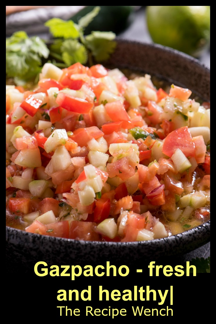 Gazpacho is a super healthy and easy dish -- a little olive oil, seasonings and vegetables. Who wouldn't love that?! | The Recipe Wench