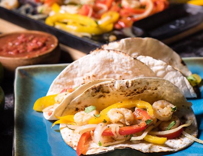 Shrimp fajitas tacos is a brilliant meal -- as perfect for hectic weekday meals as they are for leisurely weekend meals.