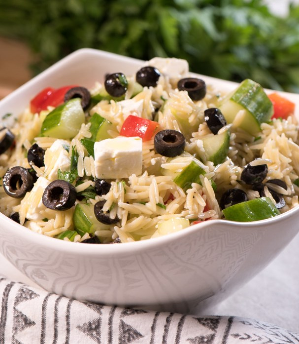 Orzo Salad full of feta, black olives and fresh cucumbers and red peppers - drizzle with a little Greek dressing and what a side dish! - Enjoy! | The Recipe Wench