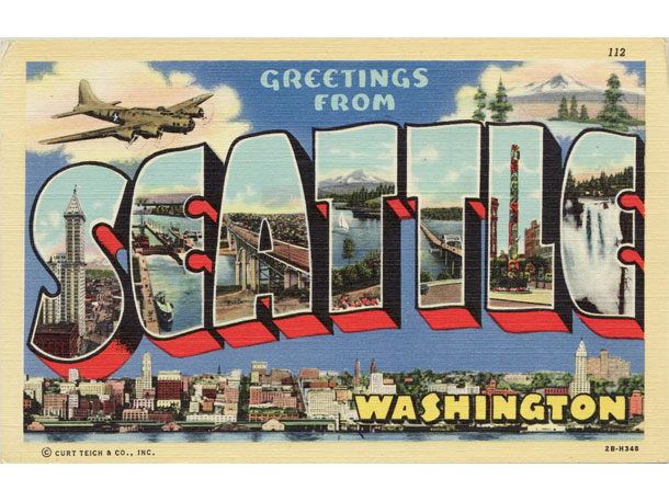 Old Postcard that reads Greetings From Seattle with pictures of the city in the letters