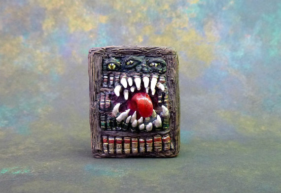 A Mimic that looks like a bookshelf. Sharp teeth and a long tongue protrude from the center.