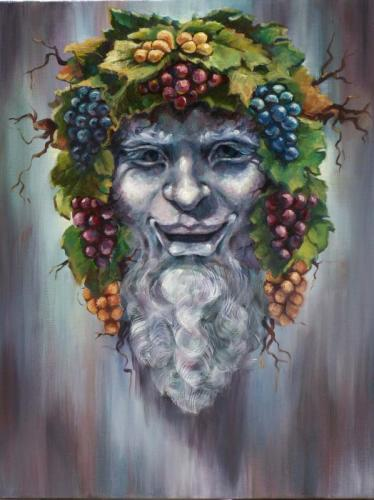 Bacchus' face wreathed with clusters of grapes