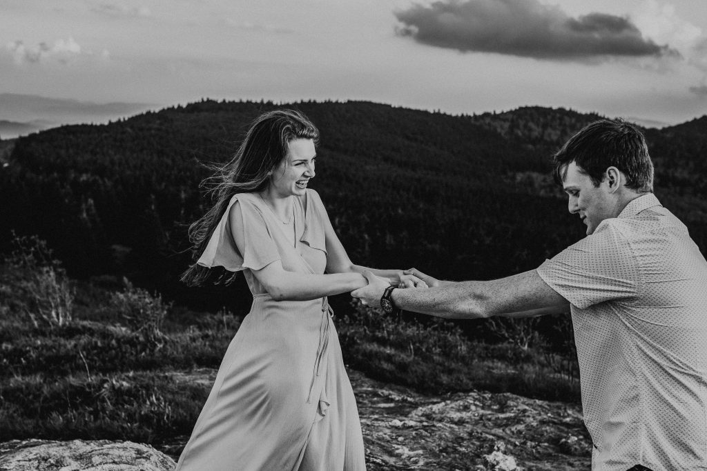 Happy, engaged couple at Black Balsam Knob