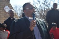Bishop David Vinjwa of the New Messengers in Zion led a crowd of men and women in song