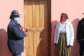 OVERWHELMED WITH JOY: Chris Hani District police commissioner, Major General Funeka Siganga, left, hands over a renovated house to Ntombi Ntshanga last week Picture: ZINTLE BOBELO