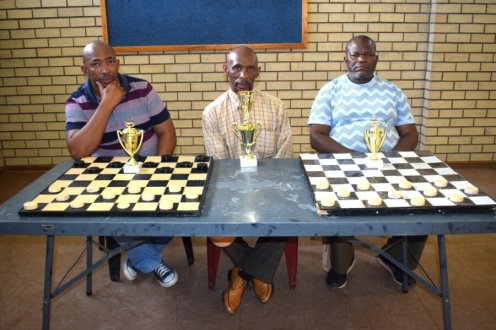 TOP CHAPS: Masakhane Draughts Club tournament top three winners were, from left, Luyanda Magxidolo, second, winner Fezile Maqaloti and Richard Tandazo, third Picture: ZINTLE BOBELO