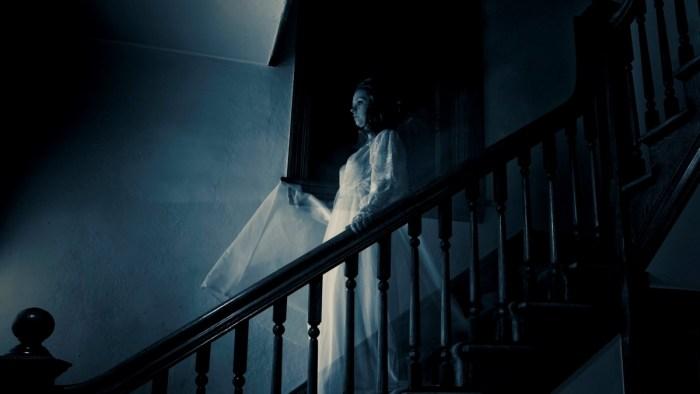 Ghost on stairway representing demonic entities