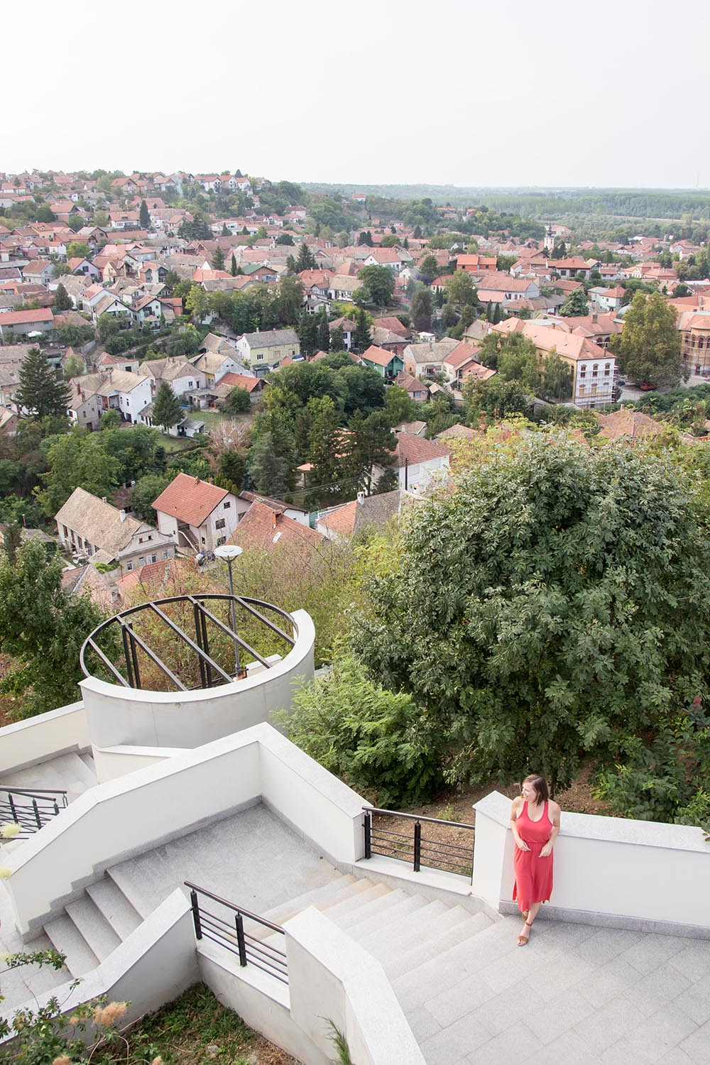 Woman looking at tiled roof tops
