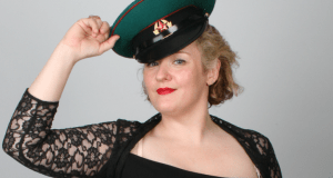 Woman wearing lacy top and Russian military cap