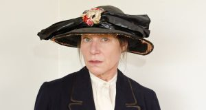 Woman in Edwardian hat and jacket