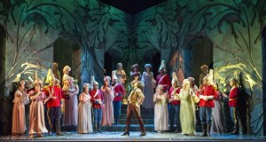 Company Members on stage in front of a woodland backdrop