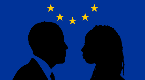 silhouettes of man and woman against EU flag