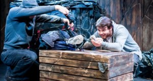 Two men and a wooden crate