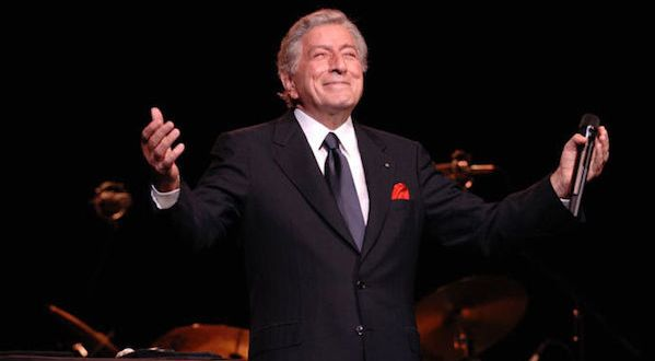 Tony Bennett smiling with hands held out