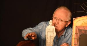Older Man and figurine