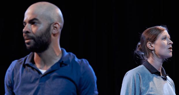 man in blue shirt woman in grey jumper