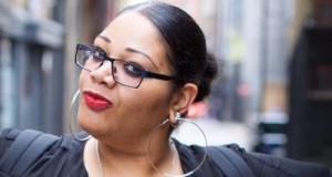 Woman with glasses and huge earings