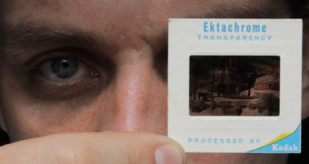 man looking at a film slide