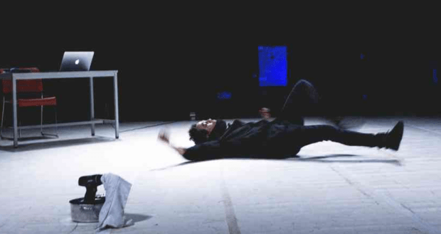 man lying on white floor