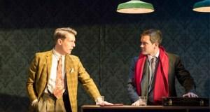 two men talking at a bar