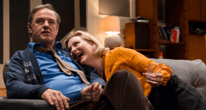 man and a woman drunk sitting on a sofa who's afraid of virginia woolf