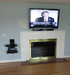 new fairfield ct tv mounting over fireplace with on wall shelf and in wall wires 1 [ 4000 x 2248 Pixel ]