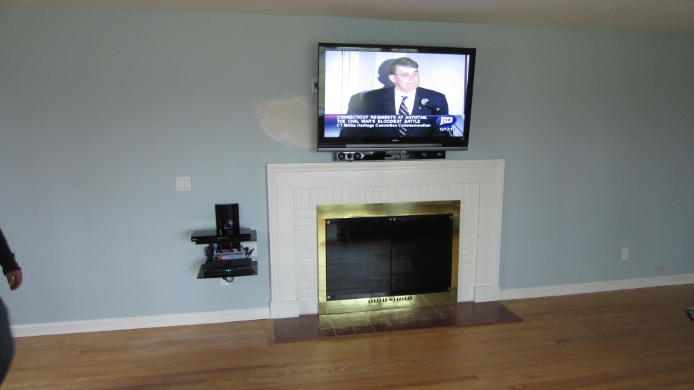 medium resolution of new fairfield ct tv mounting over fireplace with on wall shelf and in wall wires 1