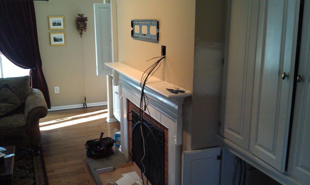 medium resolution of wallingford ct lg tv over fireplace with wires concealed and ir repeater kit 11