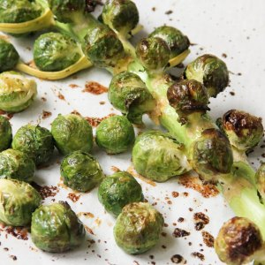 Brussels Sprouts Roasted on the Stalk with Maple Butter Dijon Glaze
