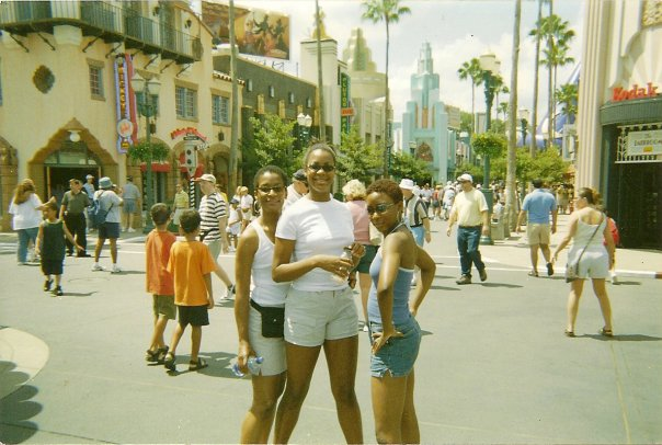 "My mother, my statuesque ""little"" sister, Kendra and me at Disney World, circa 2003."
