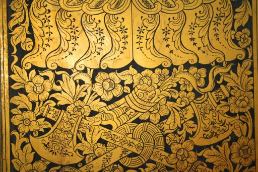 Door art in the temple of the reclining buddha, bangkok, thailand