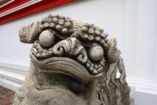 statue in wat po, bangkok, thailand