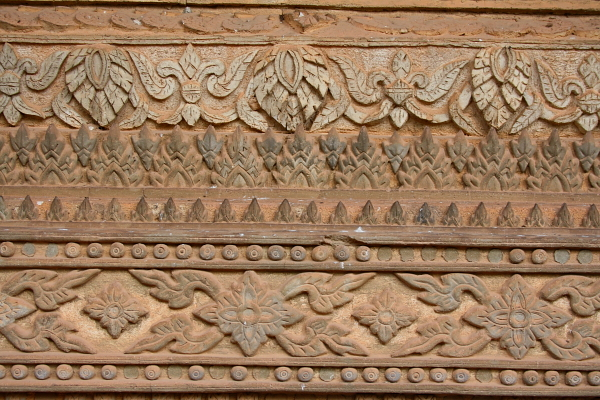 carving on the wall at Ho Phra Keo in Vientiane, Laos