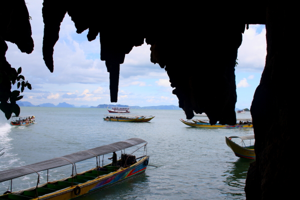 Boats from sea caves at James Bond Island, Thailand