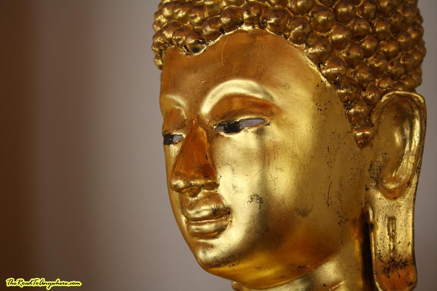 A golden Buddha face at Wat Pho in Bangkok, Thailand
