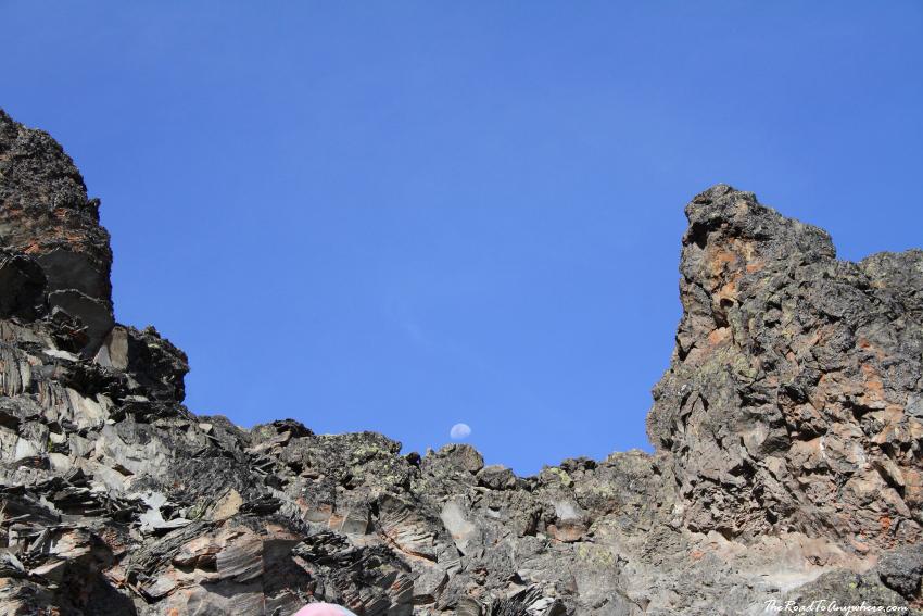 The moon above rocks on Mount Kilimanjaro, Tanzania
