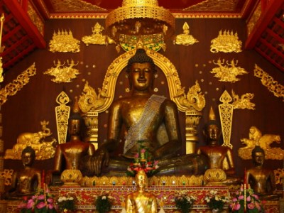 600 year old Bronze Buddha at Wat Phra Kaew in Chiang Rai, Thailand