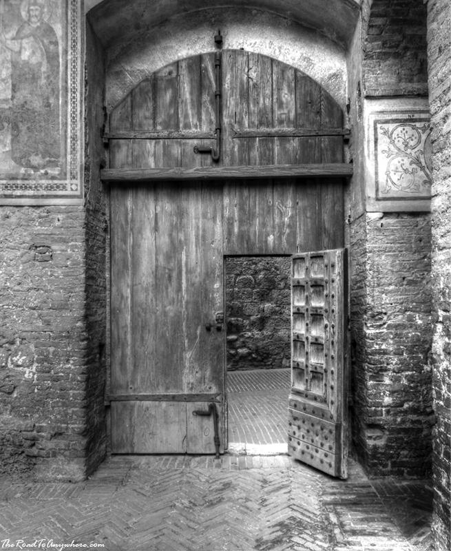 Wooden door in Palazzo Comunale in San Gimignano, Italy