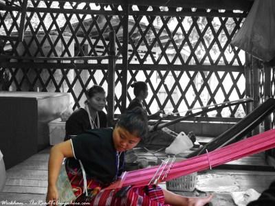White Karen women making traditional garments at a village in Thailand