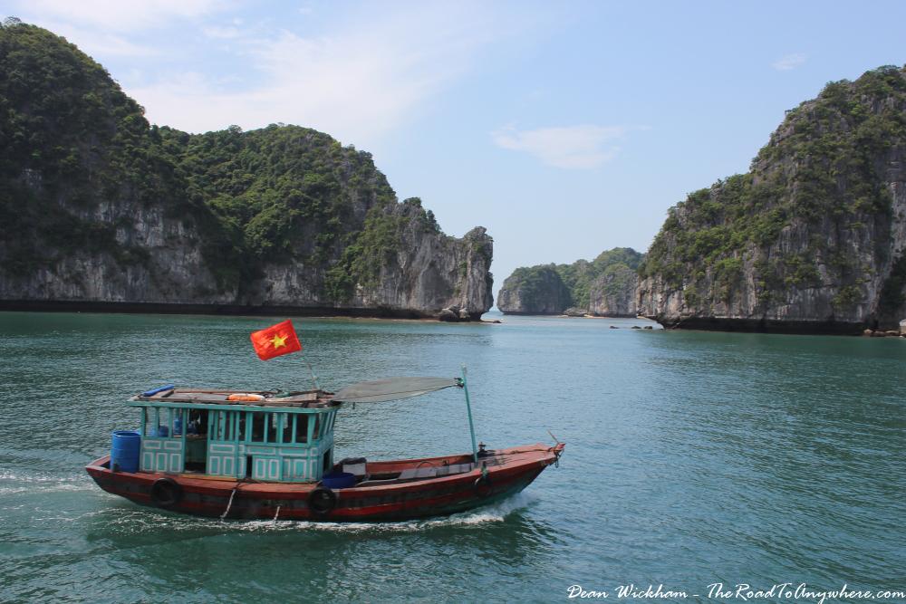 Passing by a local boat in Han La Bay, Vietnam