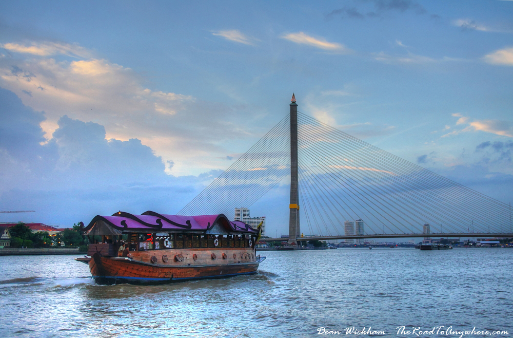 Wooden Boat in front of Rama VIII Bridge in Bangkok, Thailand