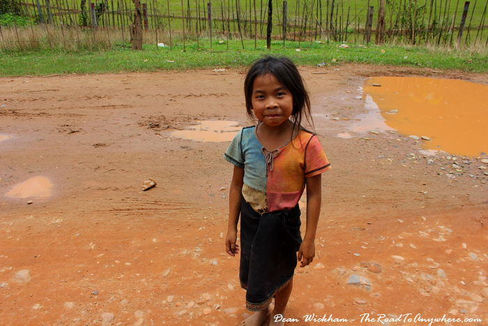 Young Lao child smiles for a photo near Vang Vieng, Laos