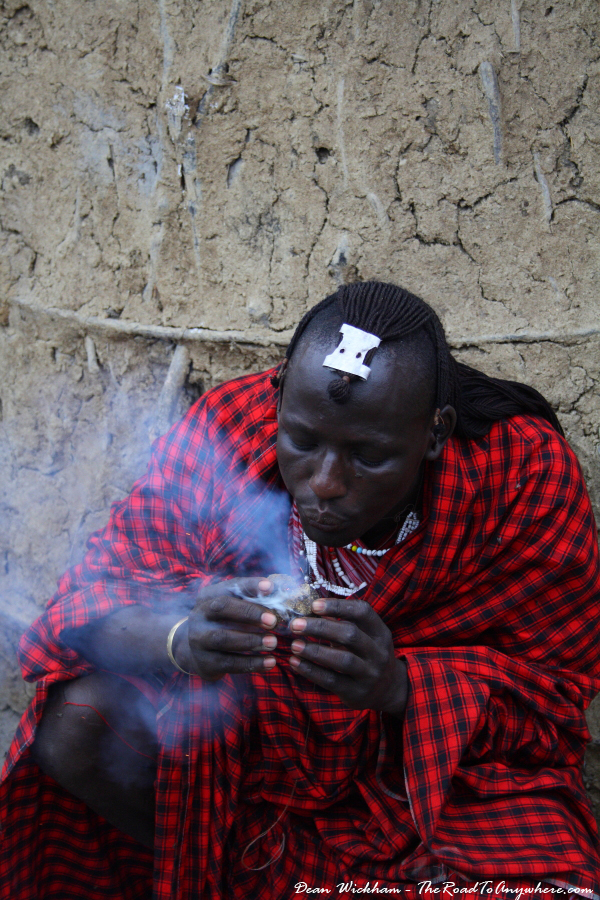 Masai man making fire with donkey dung in Lake Manyara, Tanzania