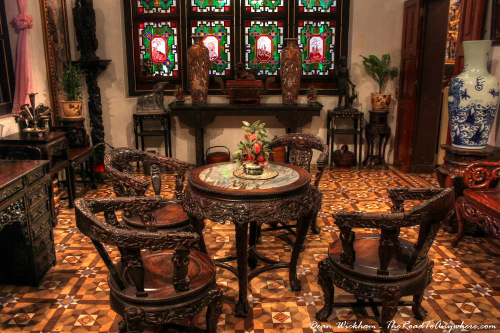 Antique table and chairs in Pinang Peranakan Mansion in George Town, Malaysia