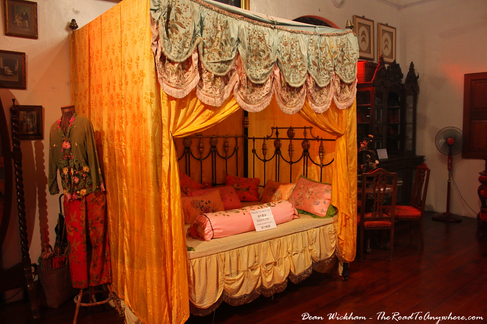 A bed in one of the bedrooms in Pinang Peranakan Mansion in George Town, Malaysia