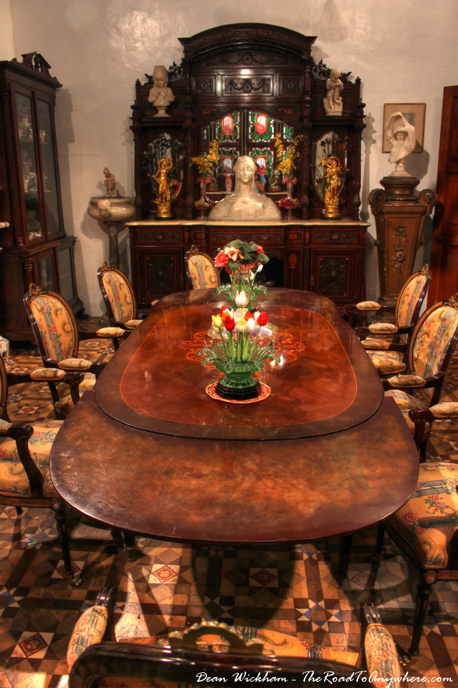 Antique dining table in Pinang Peranakan Mansion in George Town, Malaysia